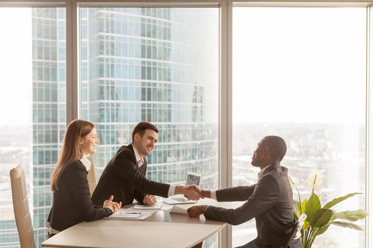 Employer shaking hands with employee